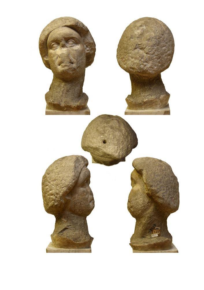 Мраморная голова скульптуры, изображающей бородатого мужчину